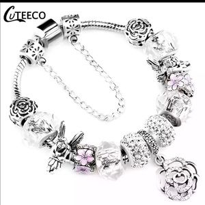 Jewelry - Brand New Pink And Silver Angel Charm Bracelet